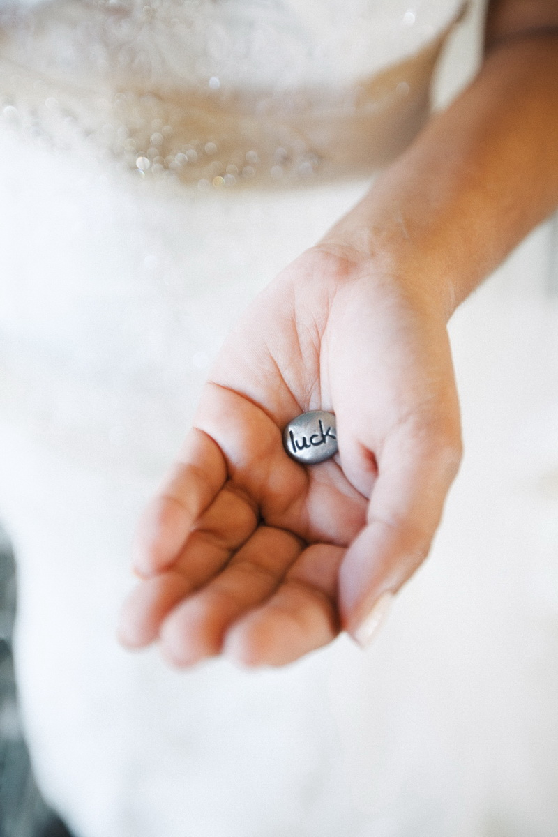 artistic temecula wedding photographer churon winery bride holding luck coin