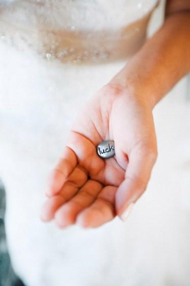 artistic temecula wedding photographer churon winery bride holding luck coin
