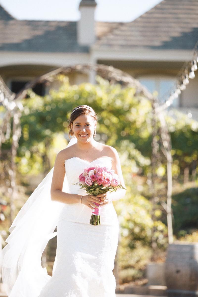 artistic temecula wedding photographer churon winery bride walking down aisle