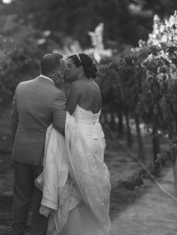 artistic temecula wedding photographer inn at churon winery couple in vineyard