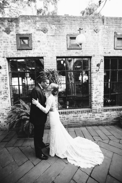 first look carondelet house wedding courtyard