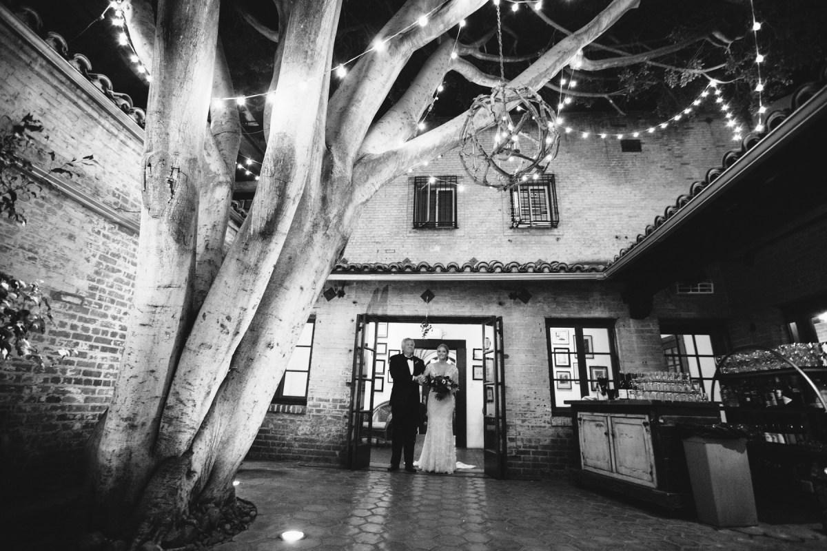 bride walking down isle carondelet house wedding