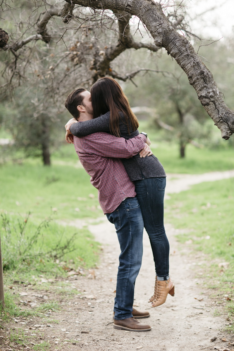 orange county engagement photographer park couple hugging