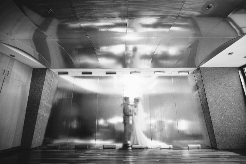 seven degrees wedding laguna beach photographer nicole caldwell couple behind glass