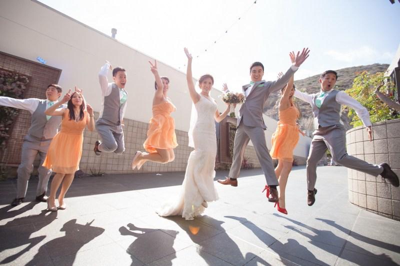 seven degrees wedding laguna beach photographer nicole caldwell bridal party jumping
