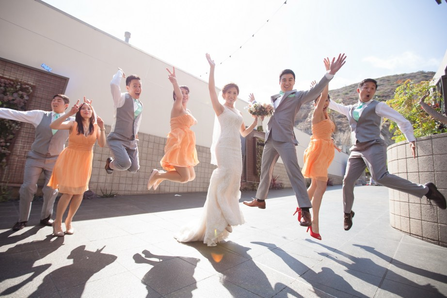 seven degrees wedding laguna beach photographer nicole caldwell bridal party jumping