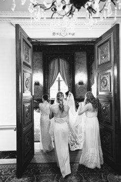 jonathan club downtown la weddings bride and groom nicole caldwell girls walking with dress