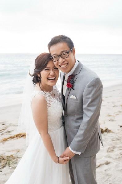 surf and sand resort wedding photographer nicole caldwell bride and groom photos on beach