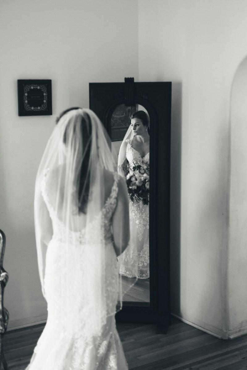 casa romantica san clemente wedding photographer artistic bride looking out window