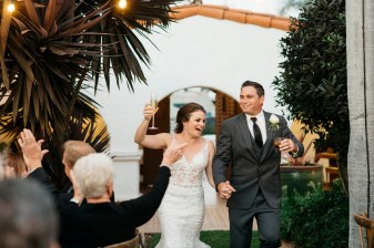 casa romantica san clemente wedding photographer artistic grand entrance bride and groom