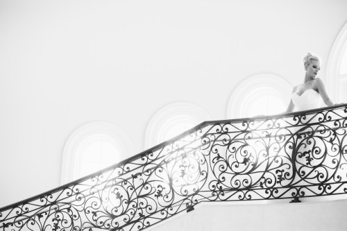 bride on stairs Monarch beach resort wedding photographer nicole caldwell