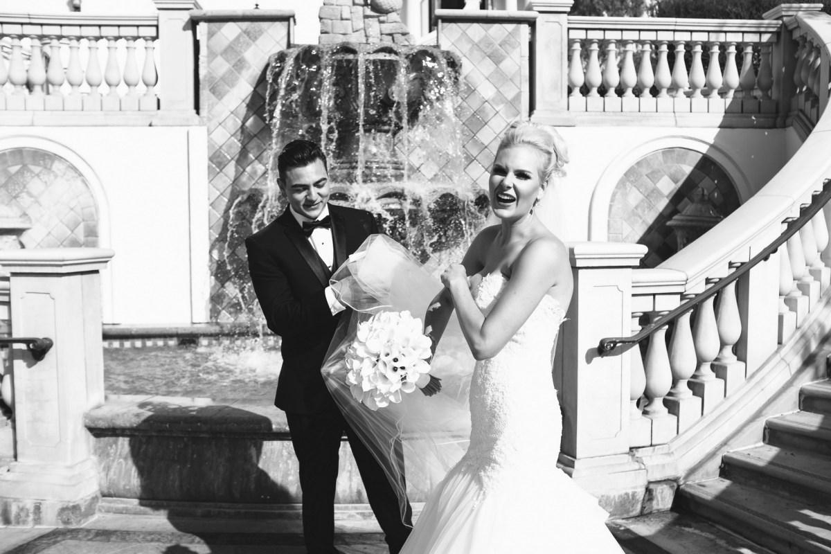 bride and groom tangles in brides veil Monarch beach resort wedding photographer nicole caldwell