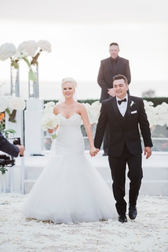 bride and groom walking down aisle Monarch beach resort wedding photographer nicole caldwell