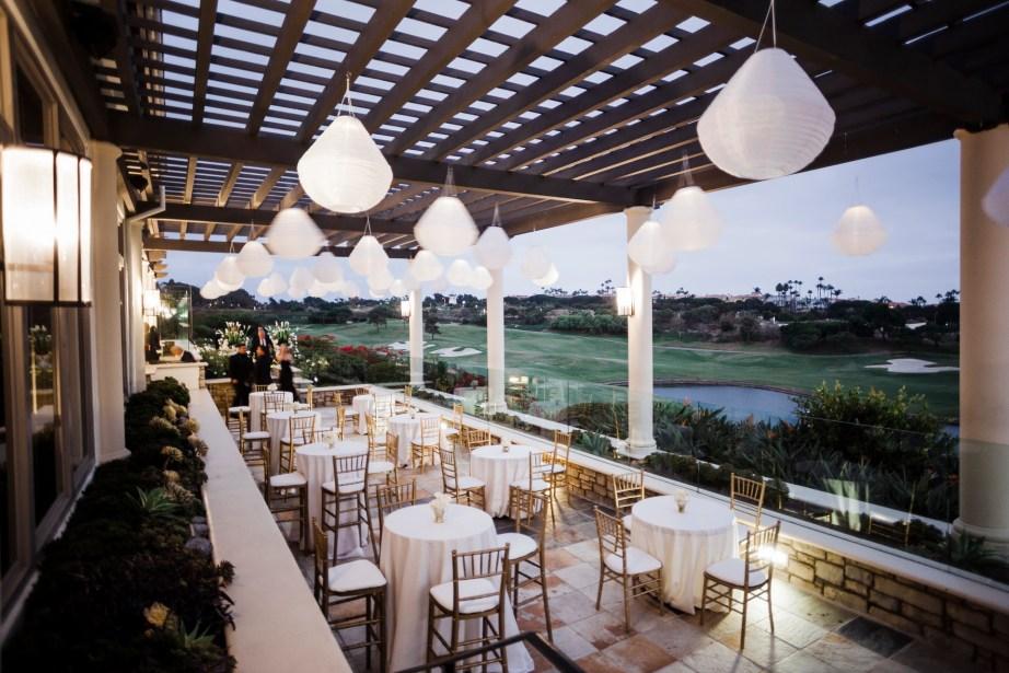 outside terrace reception Monarch beach resort wedding photographer nicole caldwell