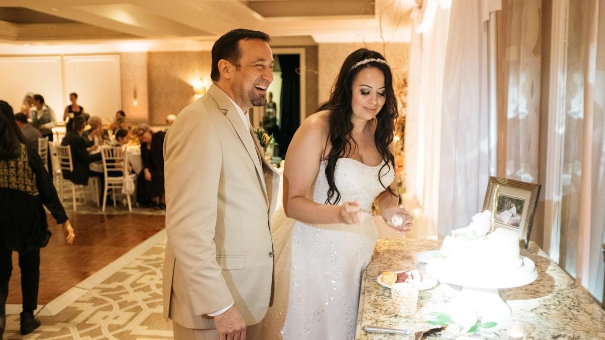 surf and sand resort wedding photographer nicole caldwell couple cutting cake