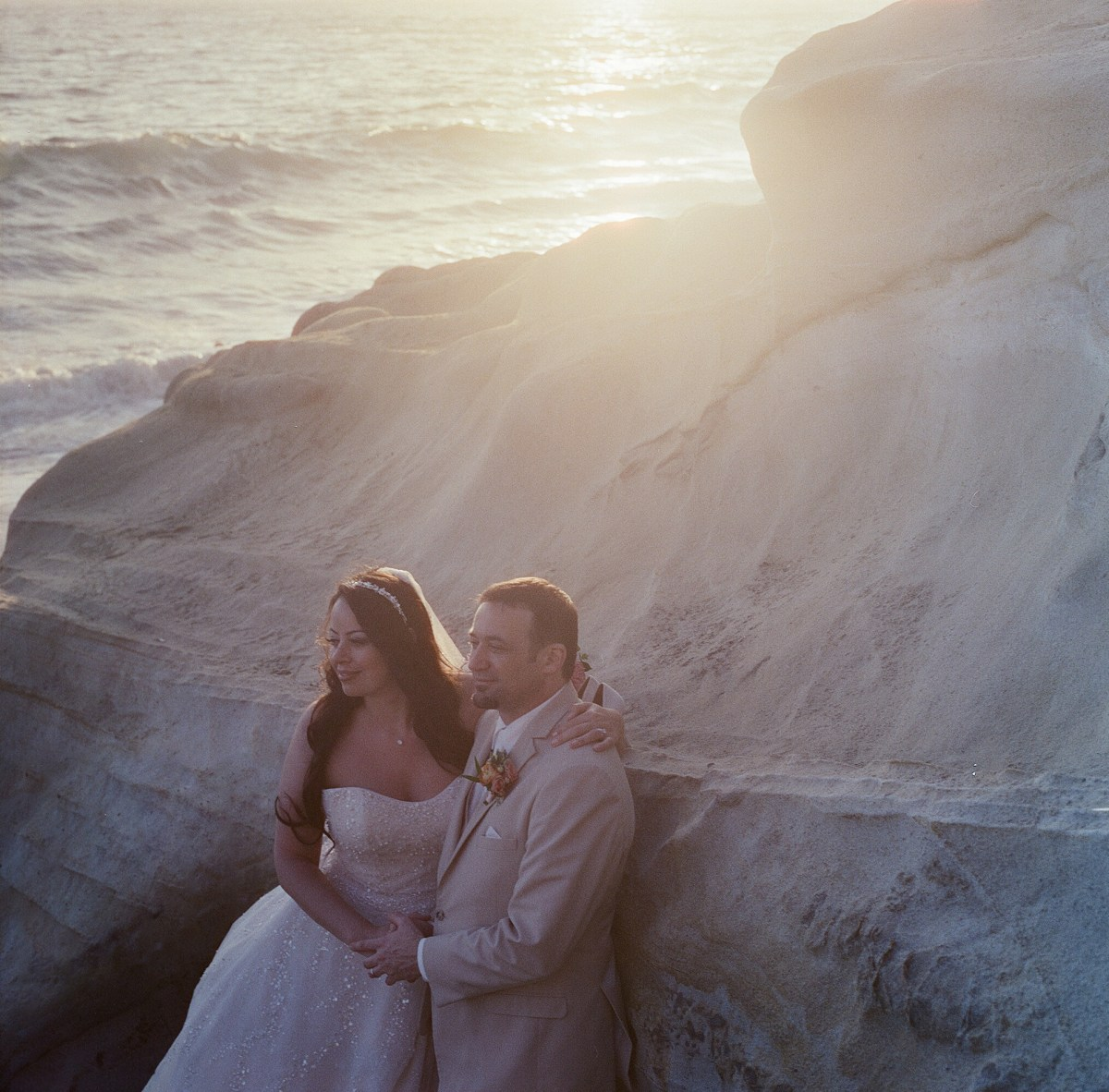 surf and sand resort wedding photographer nicole caldwell cinestill film bride and groom on beach