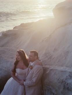 surf and sand resort wedding photographer nicole caldwell cinestill film bride and groom on beach