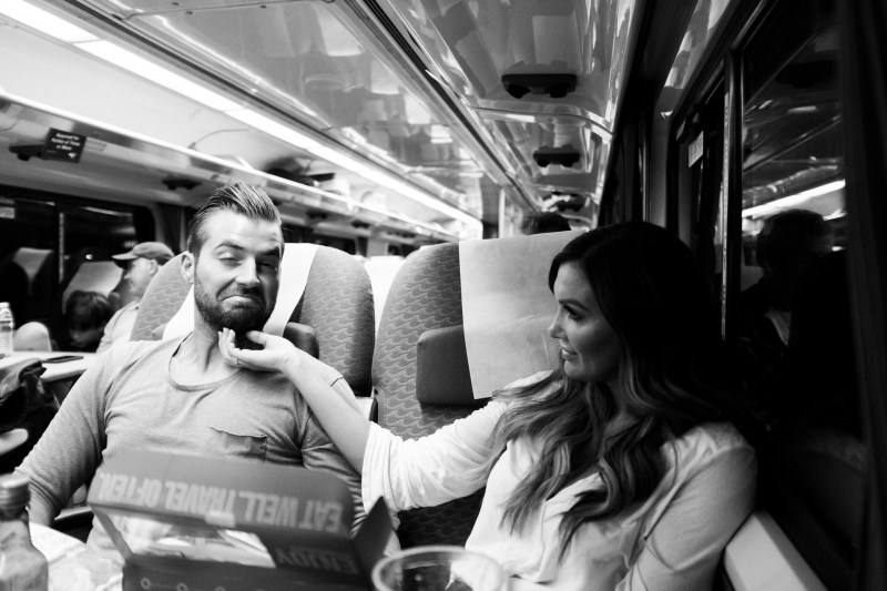 couple on train engagement photos nicole caldwell