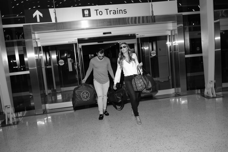 couple walking attrain station paparrazzi style nicole cadwell engagement photos