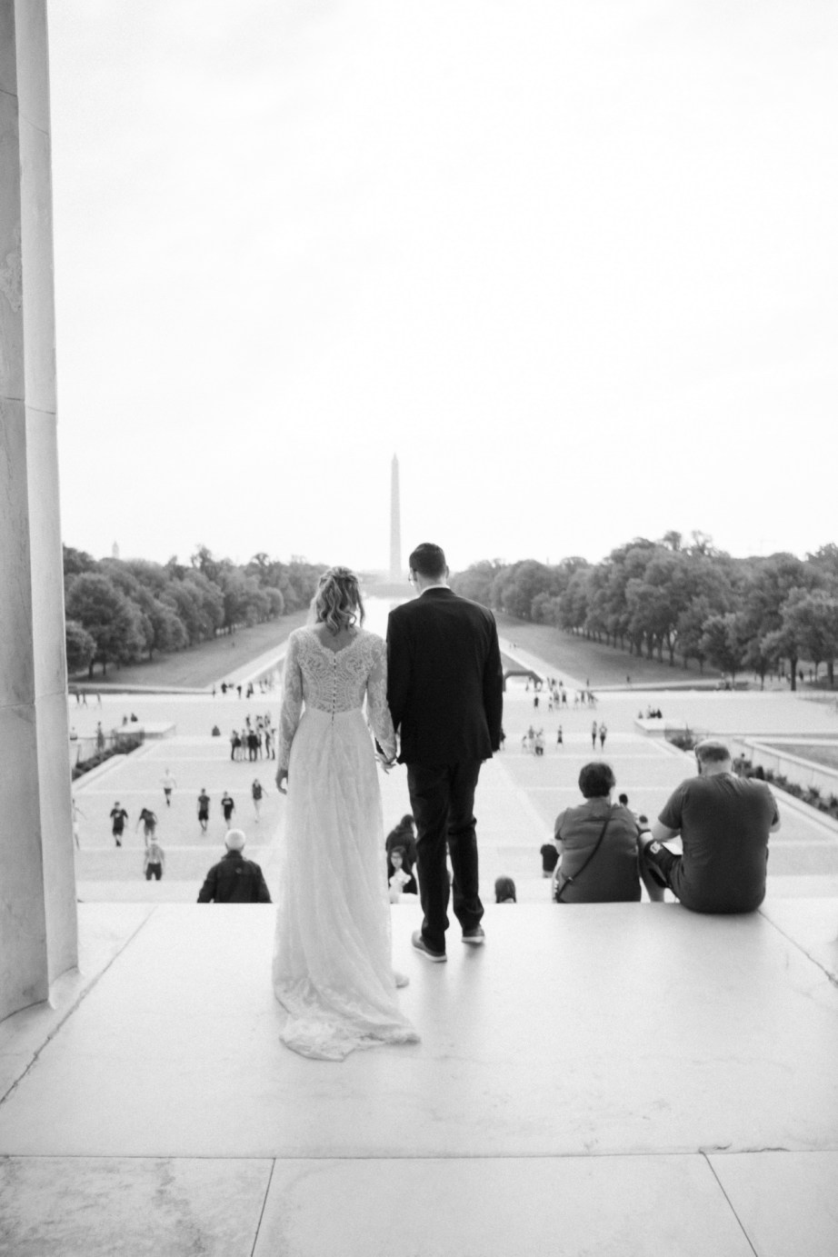 bride and groom walking at lincoln memeorial reflection pool washington dc wedding and elopement by nicole caldwell
