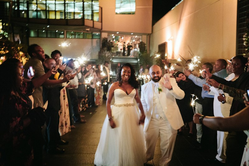 wedding bride and groom walking through sparklers 7 degrees laguna beach by nicole caldwell