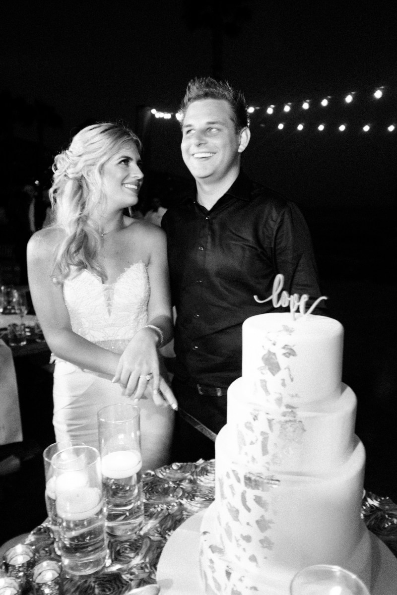 bride and groom cutting cake recption wedding montage laguna beach