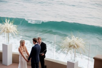 bride and groom holding hands wedding ceremony ocean terrace wedding photos surf and sand resort laguna beach