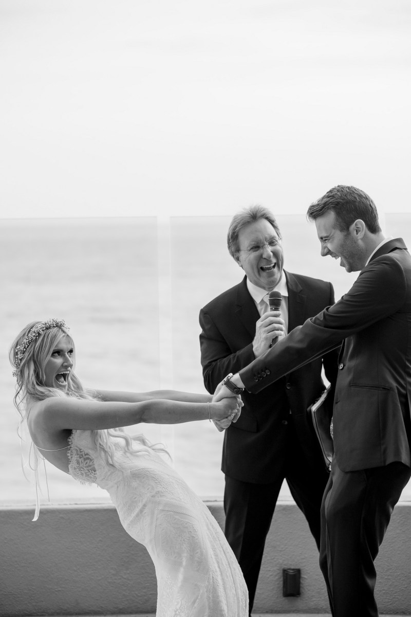 bride and groom happy wedding ceremony ocean terrace wedding photos surf and sand resort laguna beach