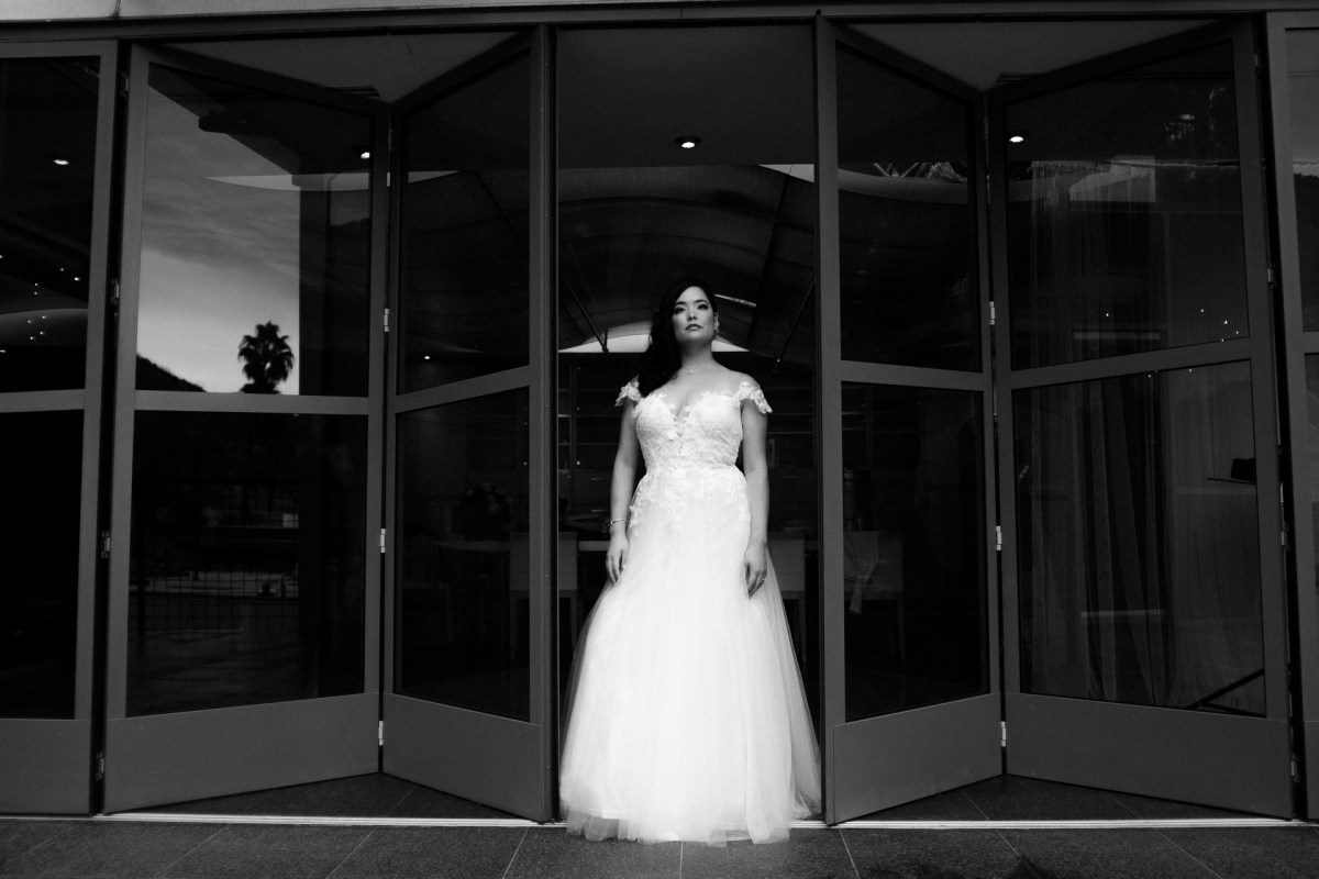 bride in window seven degrees wedding photographer laguna beach