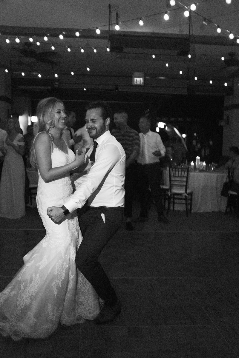 bride and groom on dance floor Coto De Caza Raquet and golf club weddings by nicole caldwell
