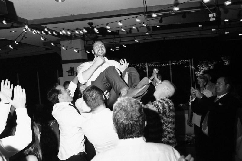 groom on dance floor Coto De Caza Raquet and golf club weddings by nicole caldwell