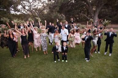 temecula creek inn weddings stonehouse ceremony bridal party jumping