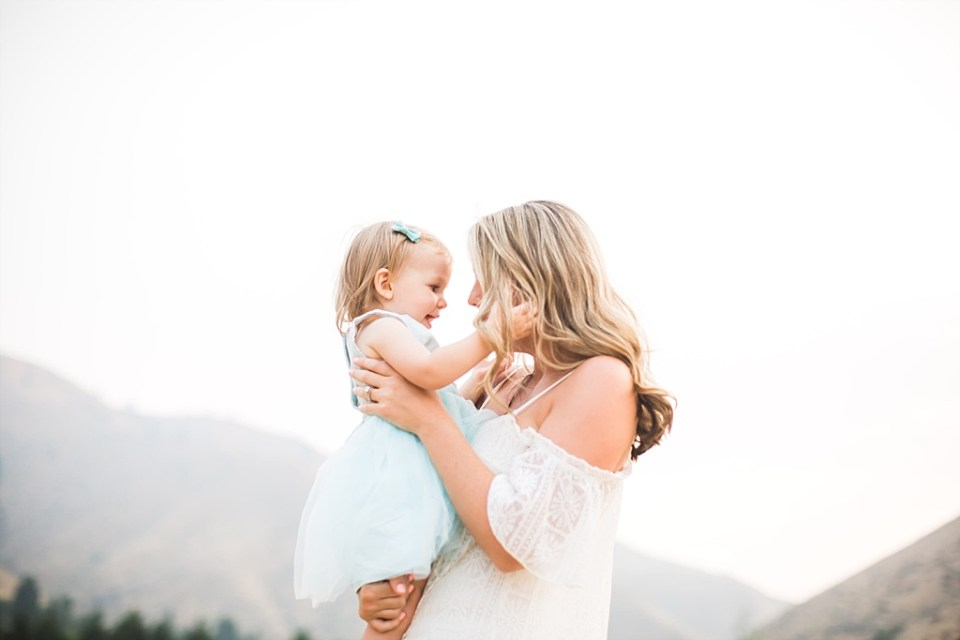 mom and daughter pose for family photos