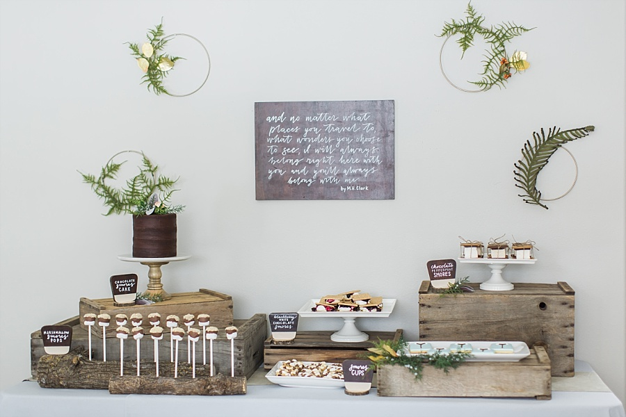 Styling a national parks baby shower with a smores cake, smores pops, diy greenery hoops, apple crates, and wood slabs