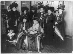 Tennie Claflin (Victoria's sister, seated in center) with suffragists, circa 1920. Photo by Bain Collection (Library of Congress) [Public domain], via Wikimedia Commons