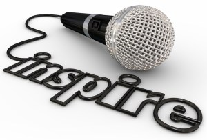 Inspire word in microphone cord to illustrate a keynote, motivational or self-help speaker sharing inspiration with a crowd or audience