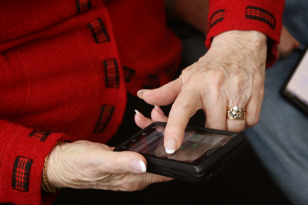 older woman's hands using touchscreen