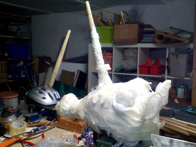 4. cover helmet with rough modeling material (in my case, plastic wrap and tape)