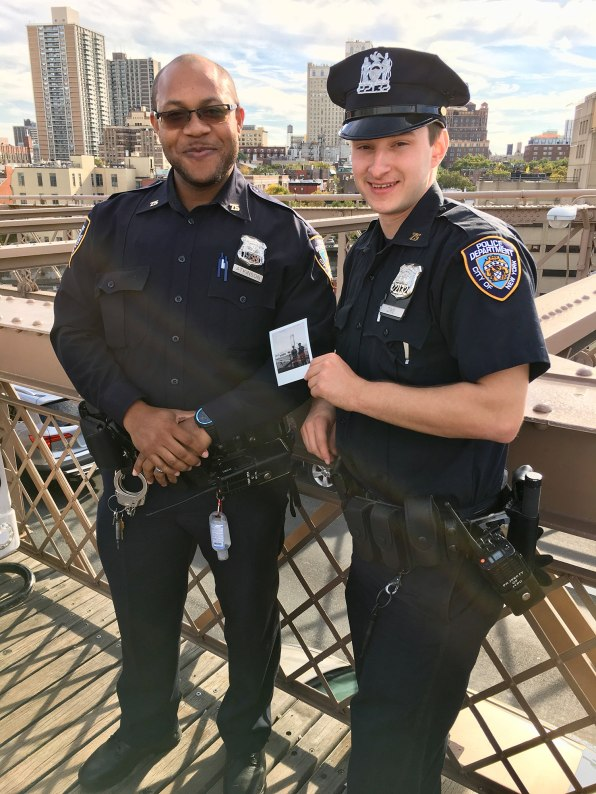 Photograph of two policemen on the Brooklyn Bridge with the Polaroid OneStep 2