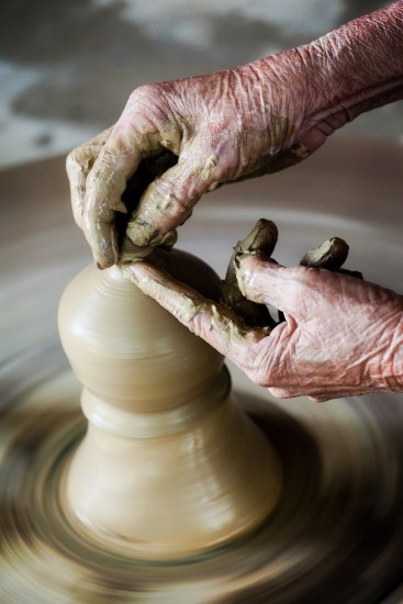 This hand-held image, photographed at 1/40 sec, allowed me to blur the movement of the pottery wheel while preventing significant movement in the hands.