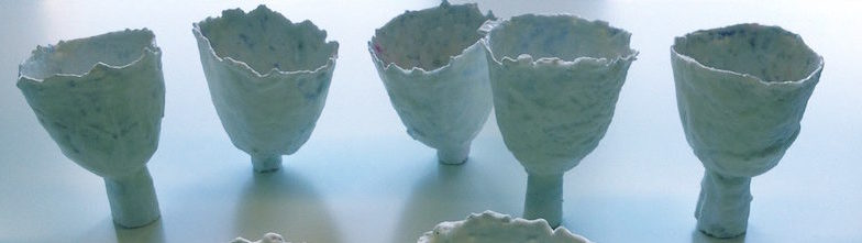 'Journal Cups' , part of a 30-piece installation, (paper, porcellain-like casting compound, wax)