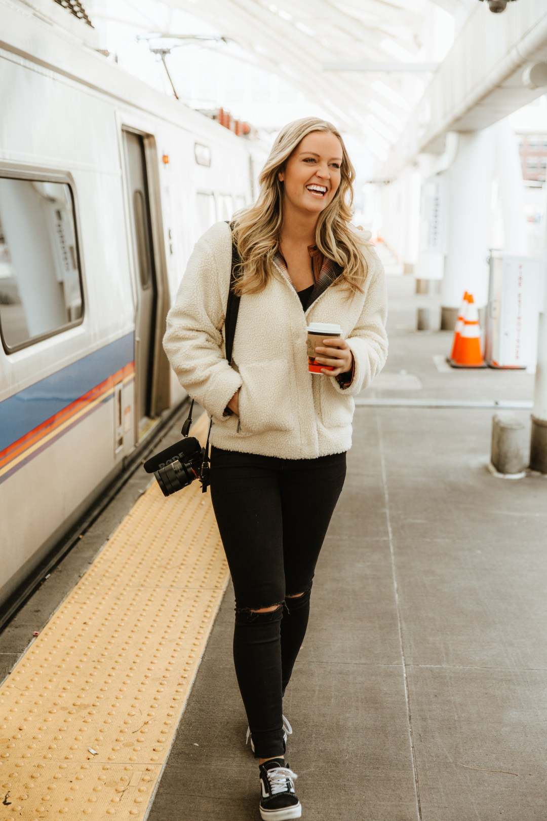 smiling girl next to train