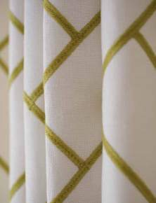 The geometric fabric for the family room draperies is from Kravet.