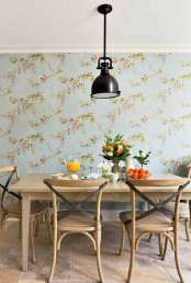 Designer Jennifer Leonard conceived the dining table and bench in the breakfast nook; the Brownstone chairs are from Nest Showroom Portland. The wallpaper supports the fresh look with its pattern of wisteria and robins. A Visual Comfort pendant creates continuity with those above the kitchen island.