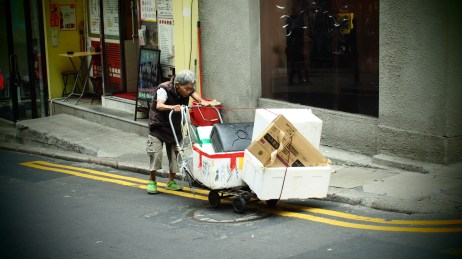common sight in HK: old people push carts full of rubbish or recycables. they resell them to make a few $