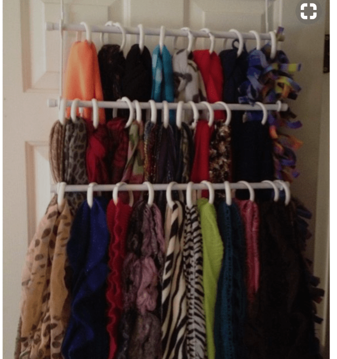 Towel bars and shower curtain rings make great scarf organizer
