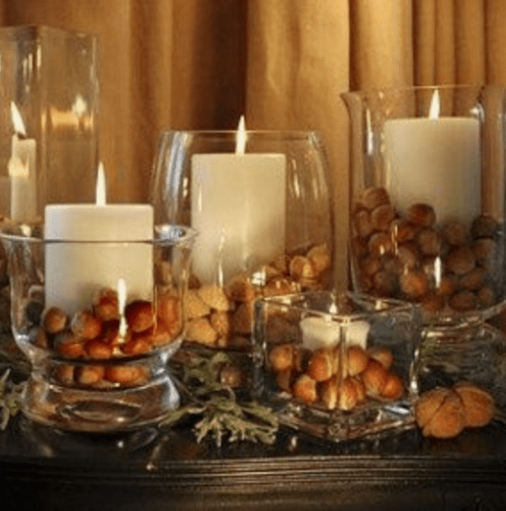 use glass jars with fruits or nuts at varies size for centerpiece or for buffet table