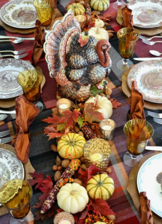 Add interesting and unique collectibles to your tablescape such as this turkey. Also added to this table are interesting colored corn and nuts.