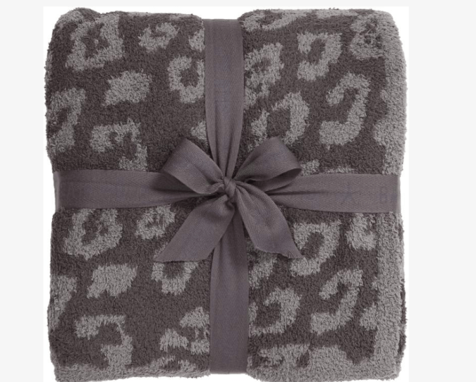 "Barefoot Dreams ""In The Wild""' throw blanket comes in several colors.  If you are not really into animal prints, don't worry, Barefoot Dreams has a solid, soft, snuggly throw just for you."