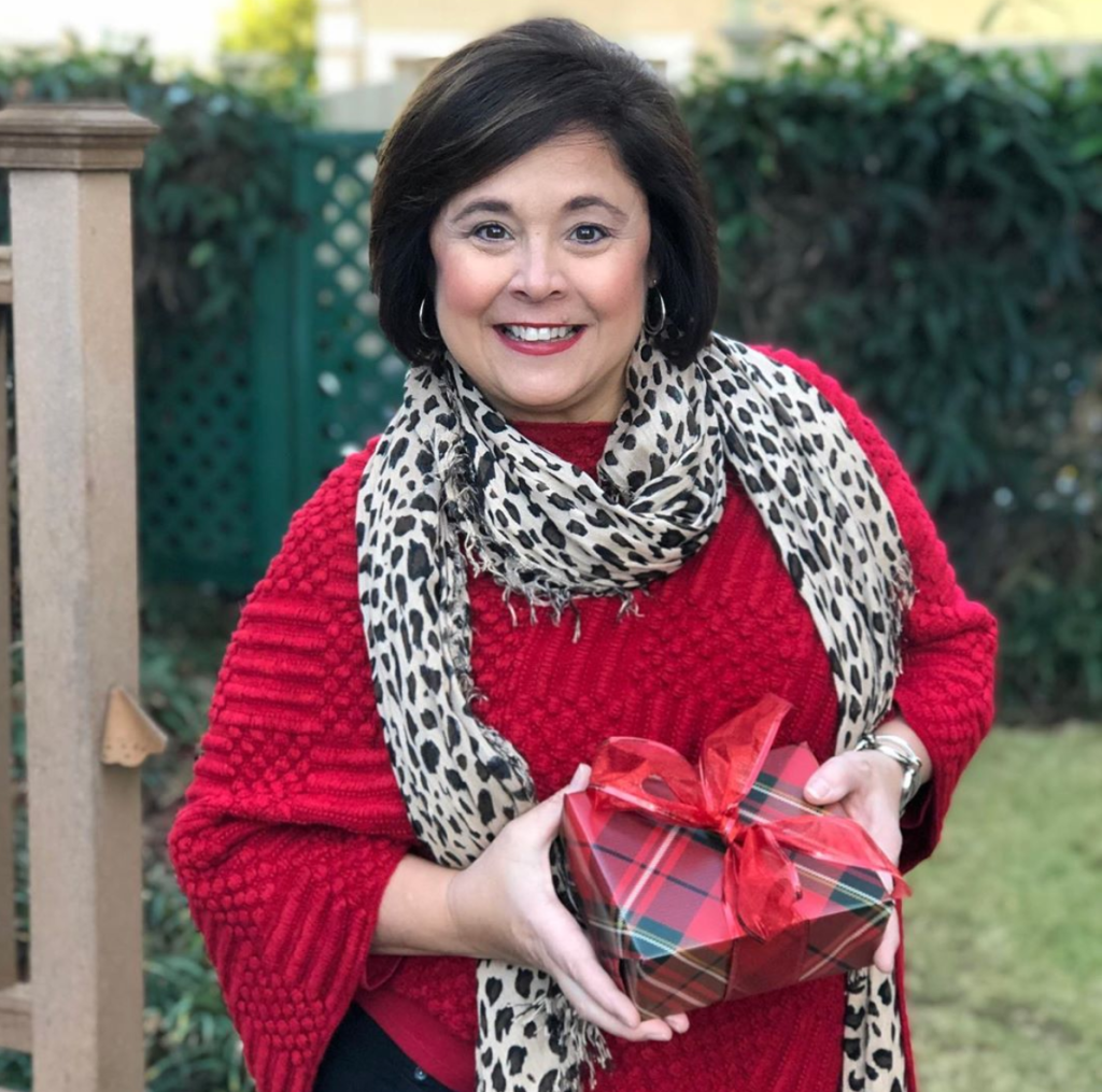 Casual holiday party look-Red poncho with animal print scarf